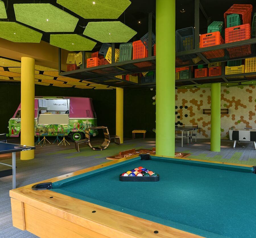 interior or the family area at hotel xcaret with a food truck and pool table