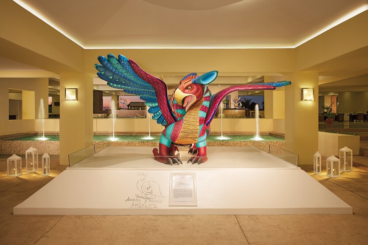 lobby interior with a colorful sculpture at dreams huatulco