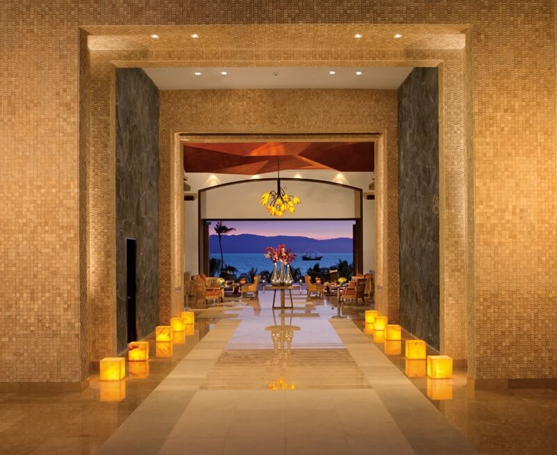 lobby area hallway with ambient lighting and ocean view