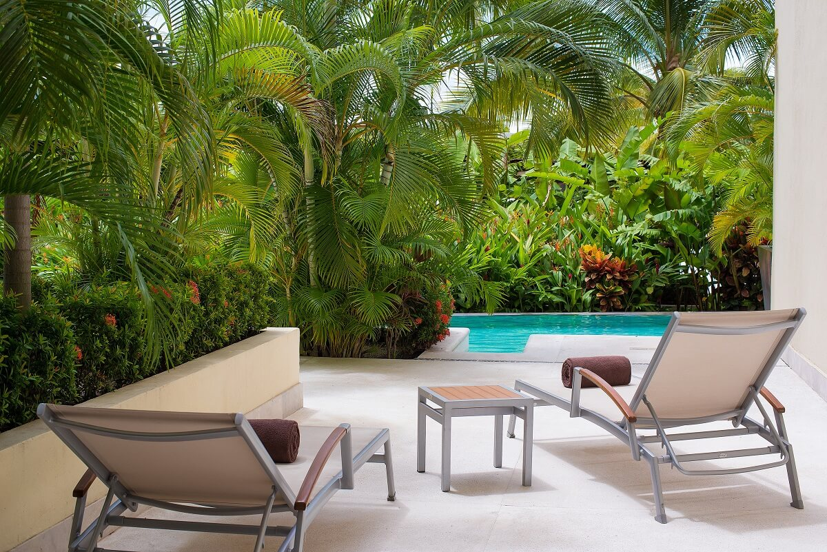 private terrace with two loungers leading to swim out pool