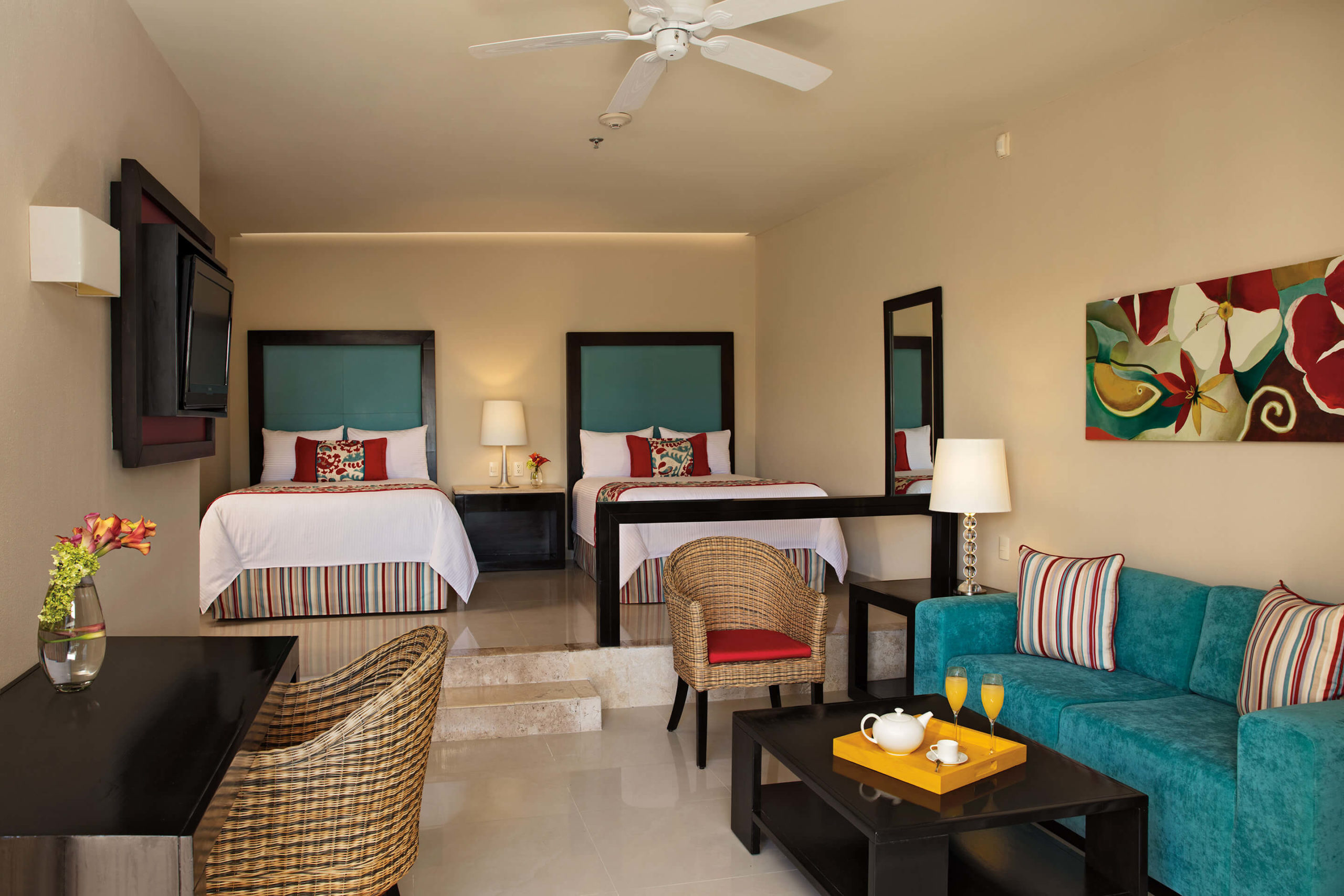 junior suite with living area and two double beds