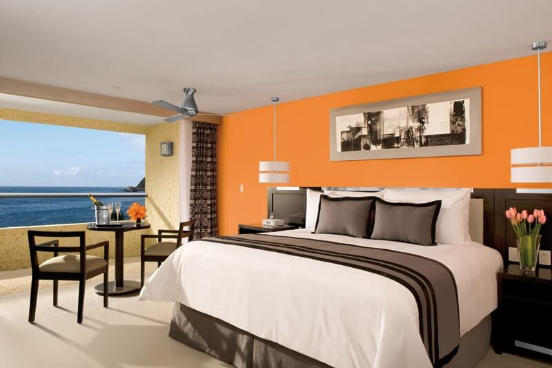 hotel room with king bed and a balcony with ocean views