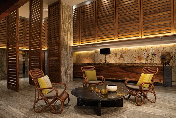 lobby area with wicker furniture at the breathless los cabos