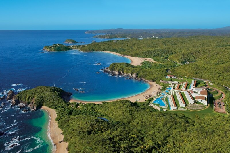 aerial view of the secrets huatulco and the sandy bays and vegetation