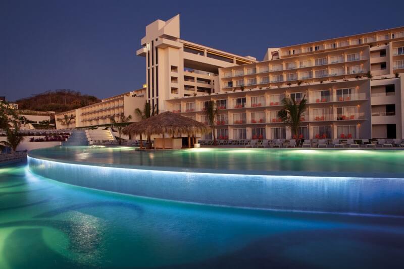 pool area at dusk secrets huatulco