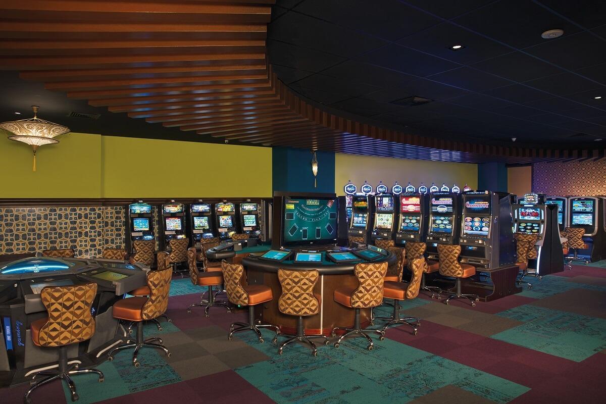 casino interior with slot machines now amber