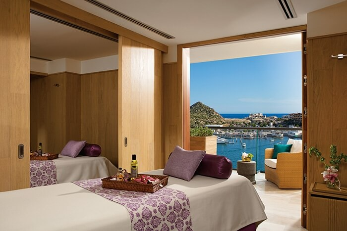 spa cabin with view of the water and a marina