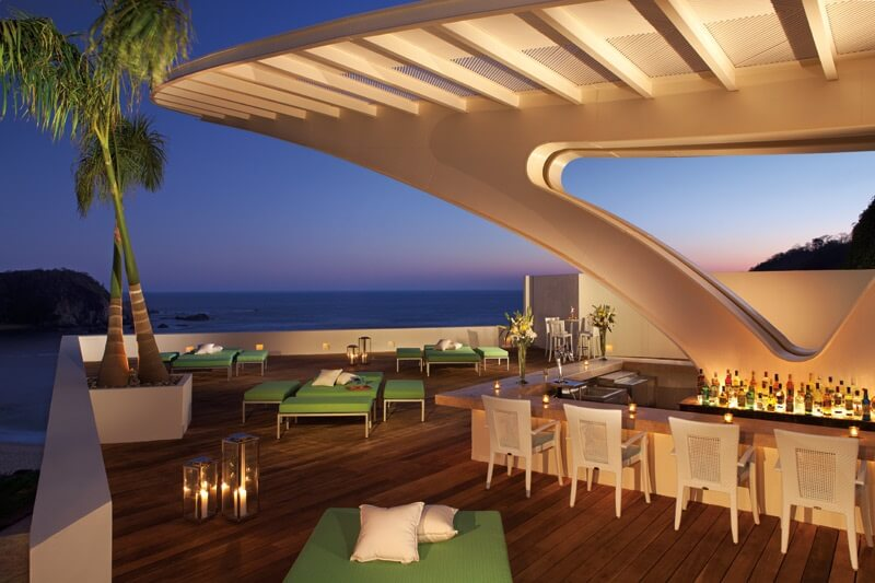 oceanview deak with bar and green lounge furniture