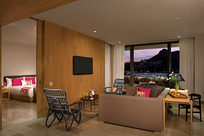 hotel suite with separate bedroom and living room area at the breathless cabo san lucas