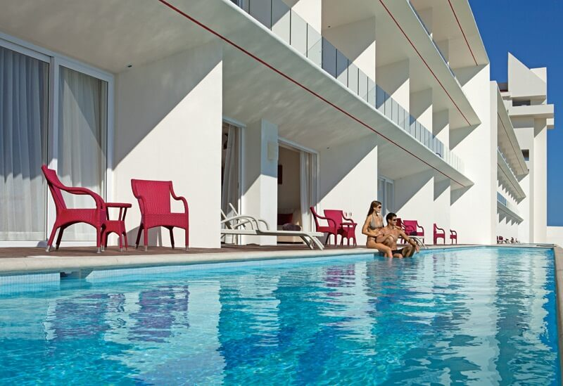 swim out room pools with terraces that have pink chairs