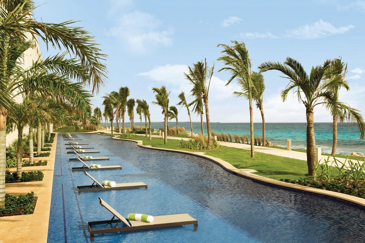 swim up pool area with loungers and ocean view hyatt ziva cancun