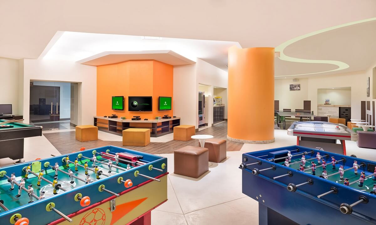 indoor games rooms with foosball and video game consoles