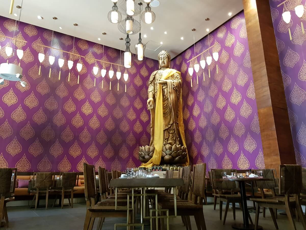 thai restaurant with giant buddha statue the fives beach