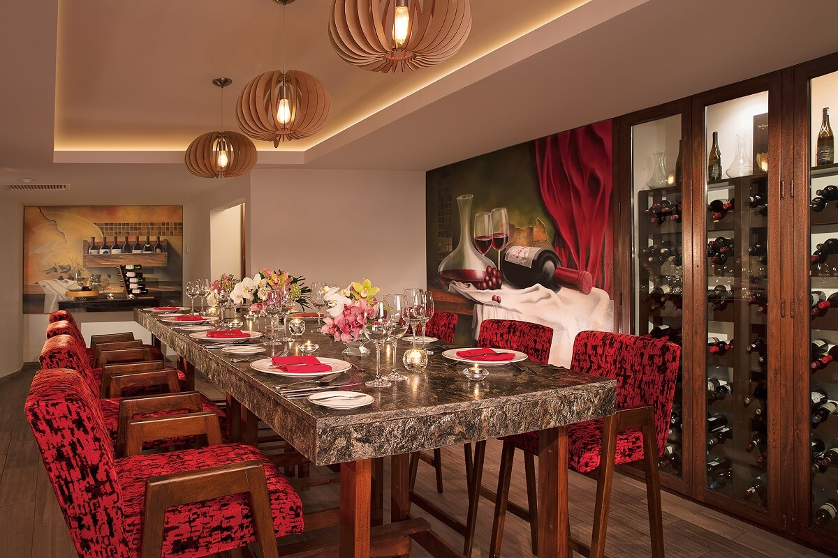 wine cellar interior with long marble table, modern red chairs