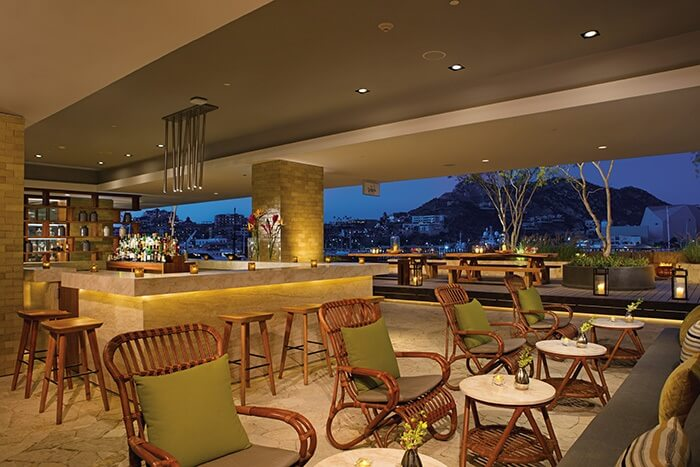 bar area with wicker furniture and open air with view of the mountains