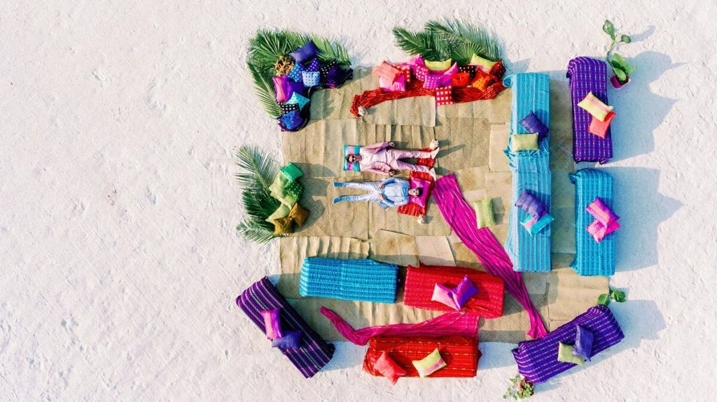 aerial view of colorful beach wedding lounge area