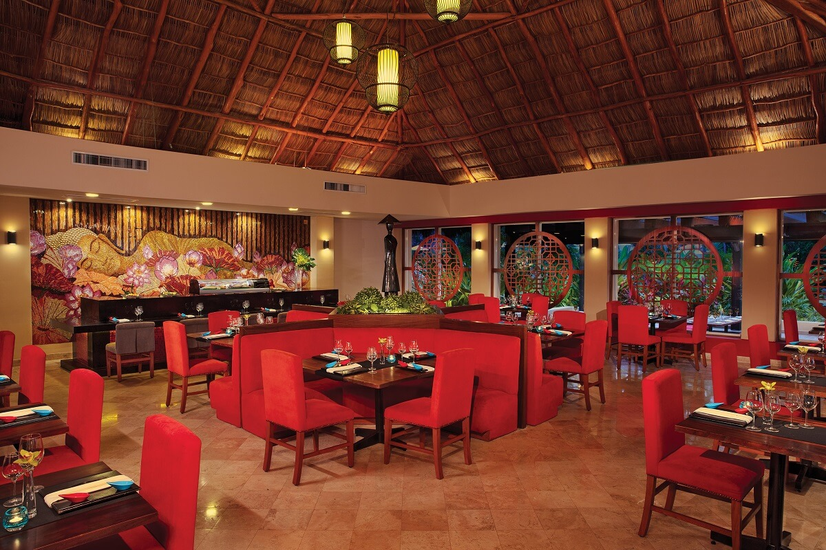 asian restaurant interior with red chairs and wooden tables