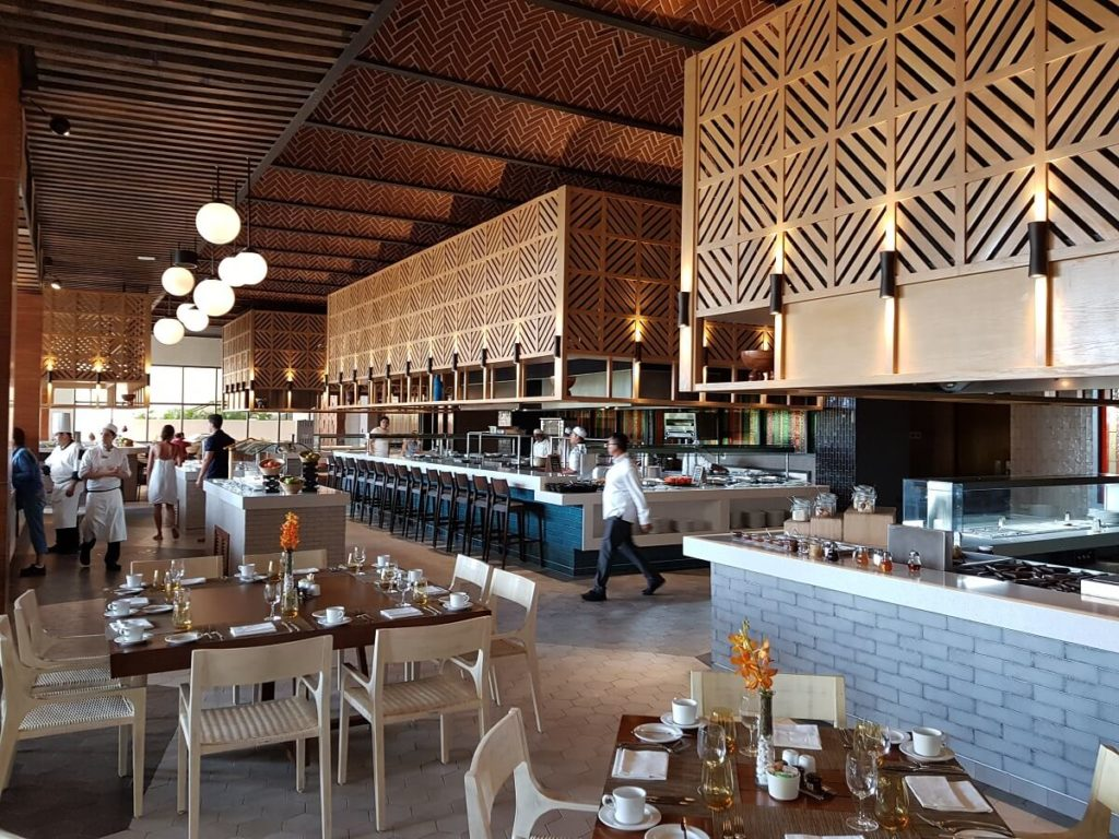 buffet restaurant interior with wooden panels and long serving stations