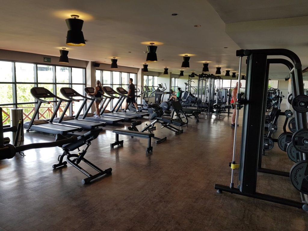 atelier hotel fitness center interior with cardio machines and large windows