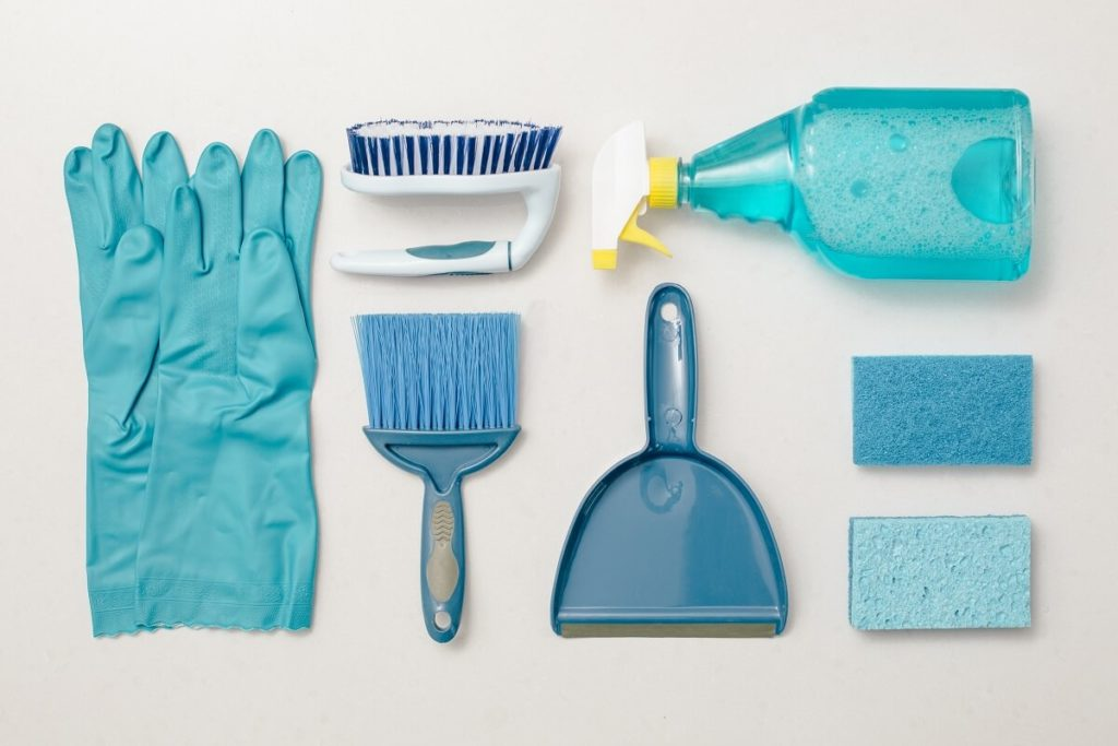 blue cleaning products including gloves, sponges, spray and brushes