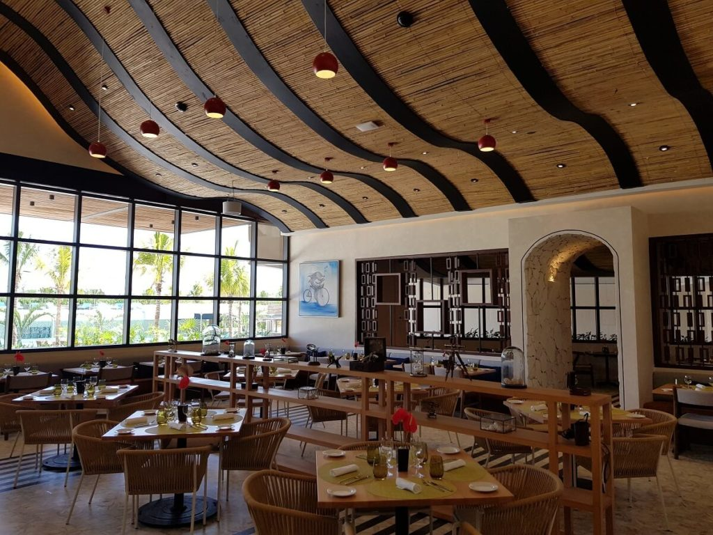 restaurant interior with wooden curved ceiling and large windows