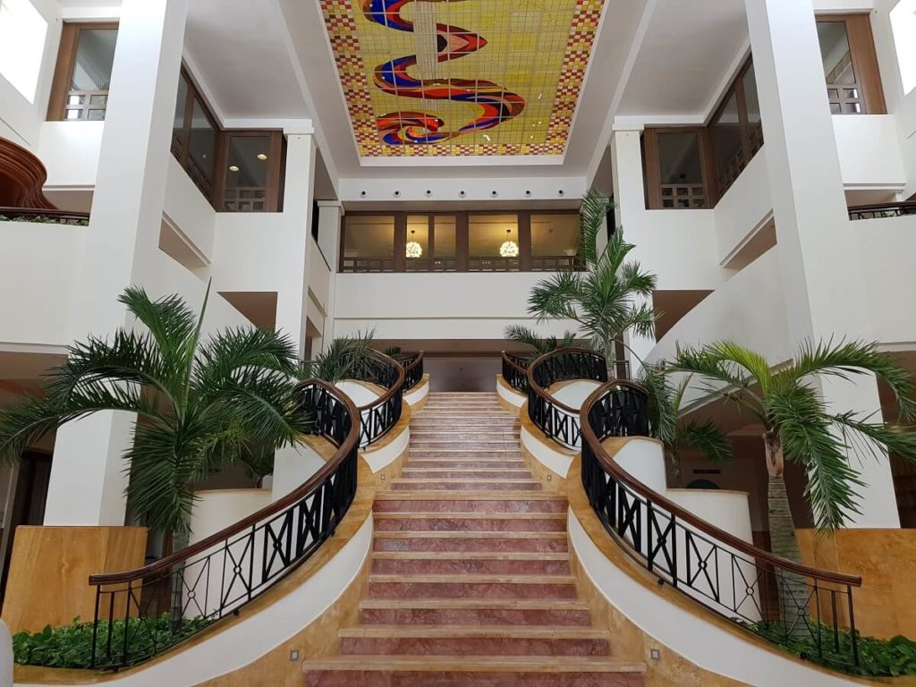 grand staircase with stained glass ceiling mosaic