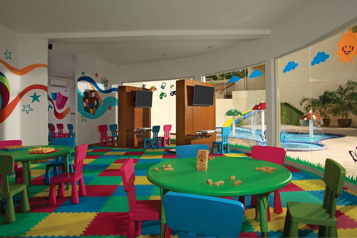 kids club interior with colorful mat flooring and child size furniture