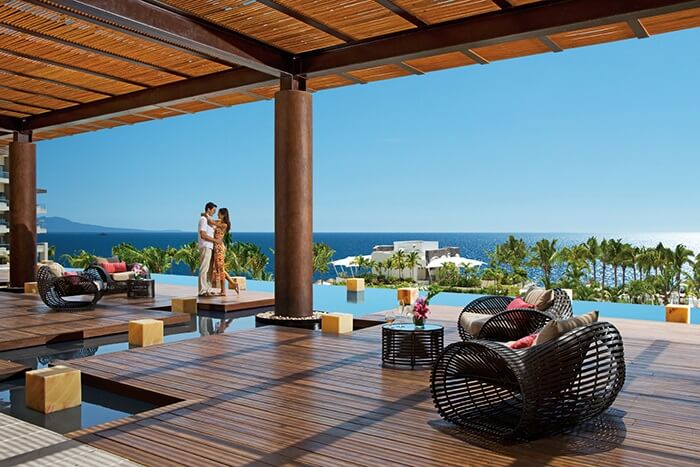 open air hotel lobby with ocean view at secrets puerto vallarta