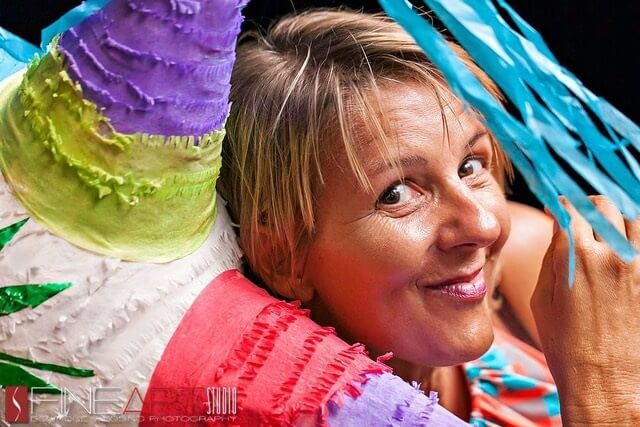 pro tips from a destination wedding planner, maria tripaldi headshot with colorful piñata