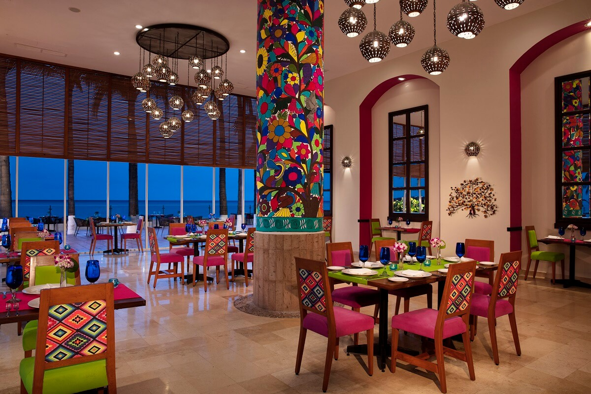 mexican restaurant interior with colorful chairs and decor