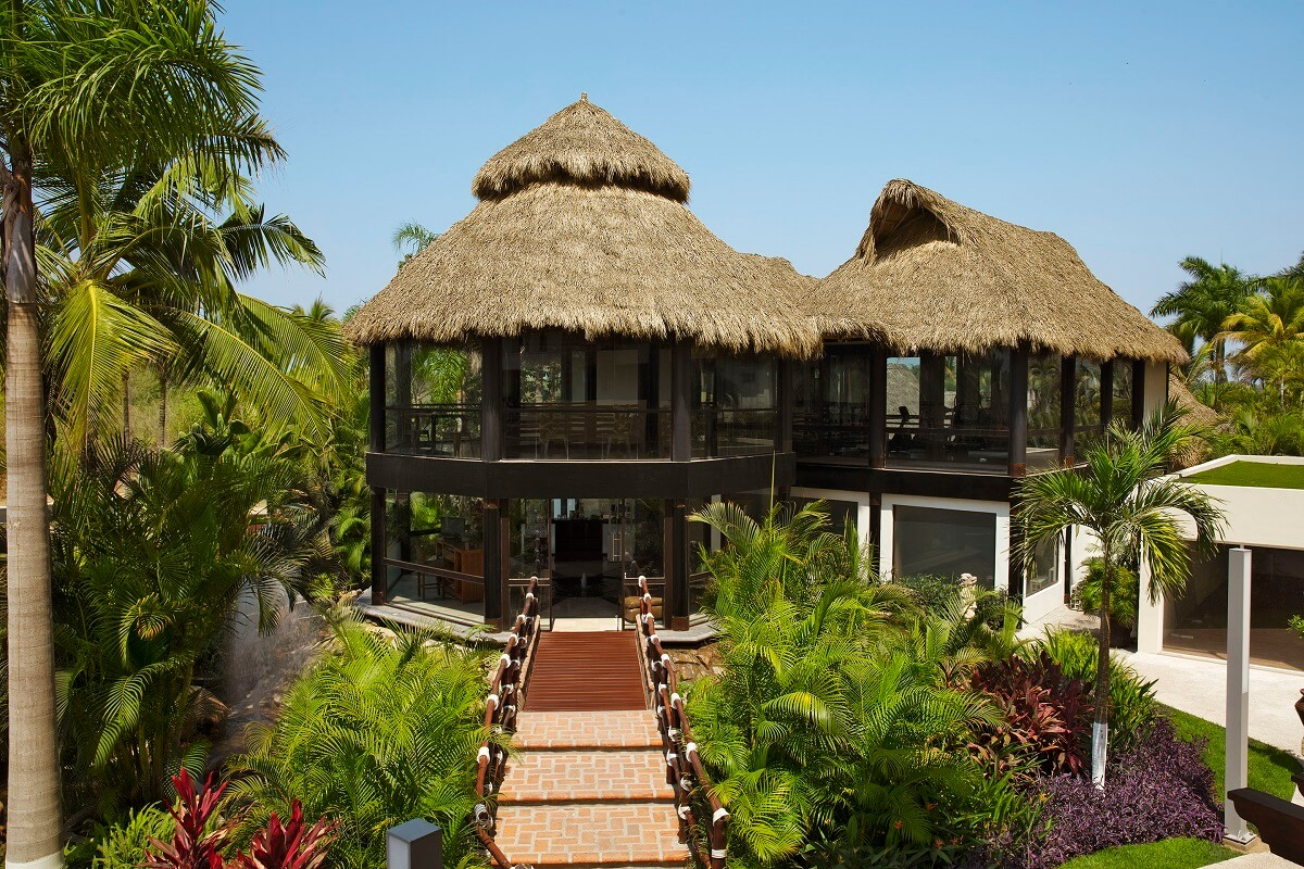 two story circular structure with thatched roof at the Reflect Nuevo Vallarta spa