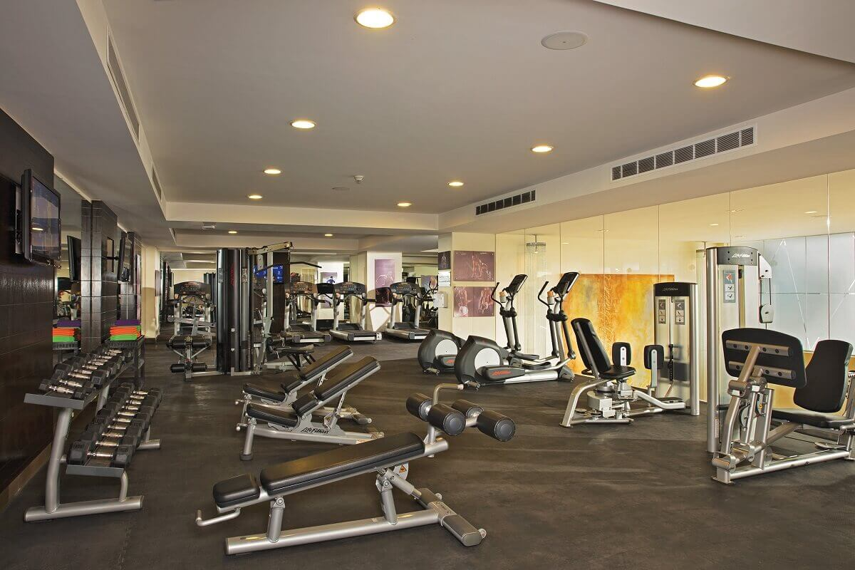 interior of fitness center iwth a variety of machines