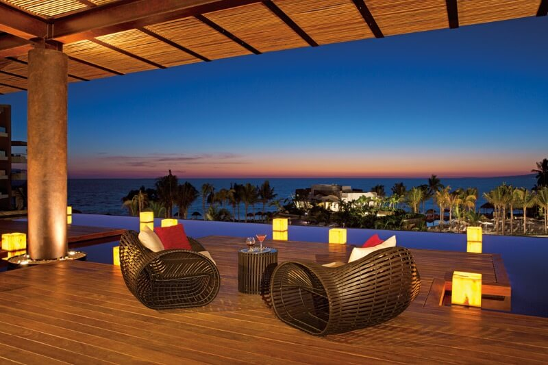 open air lobby with wicker furniture with ocean view secrets puerto vallarta