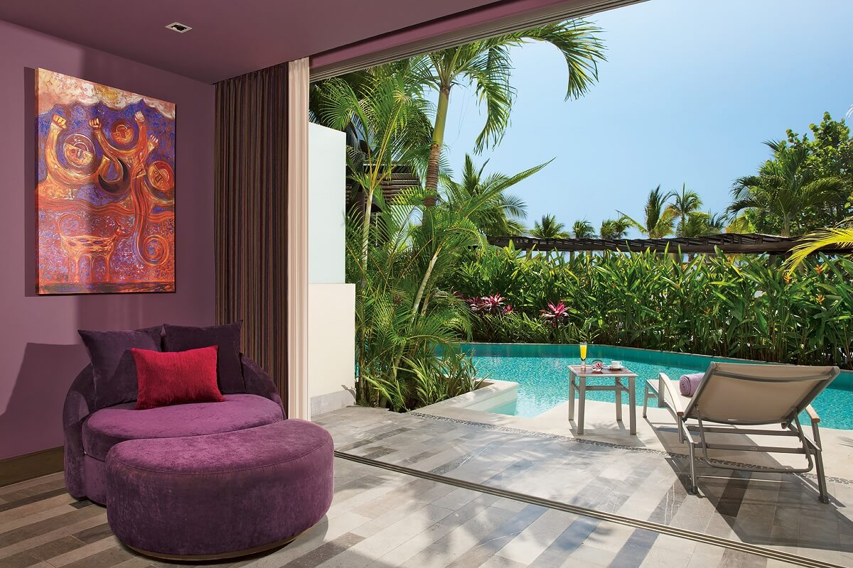 swim out room terrace with purple furniture and garden views