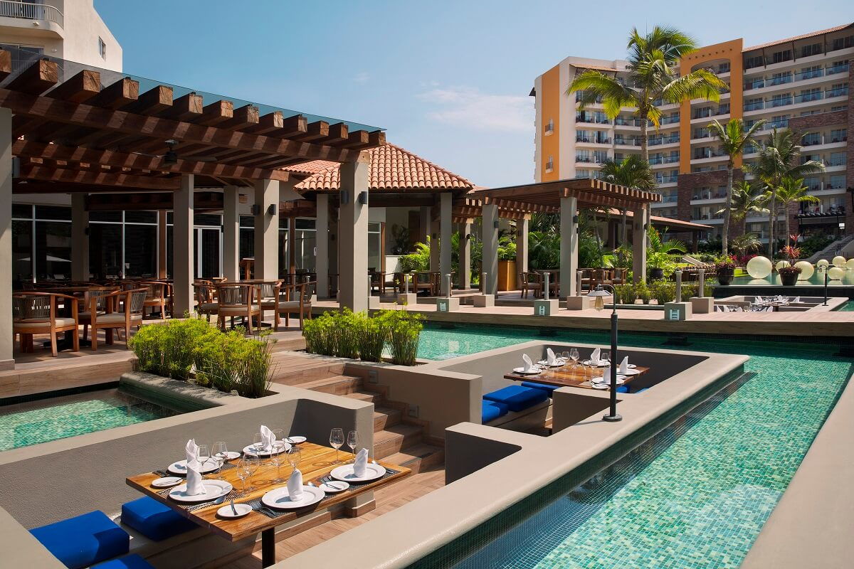 sunken tables surrounded by pools at Reflect Nuevo Vallarta
