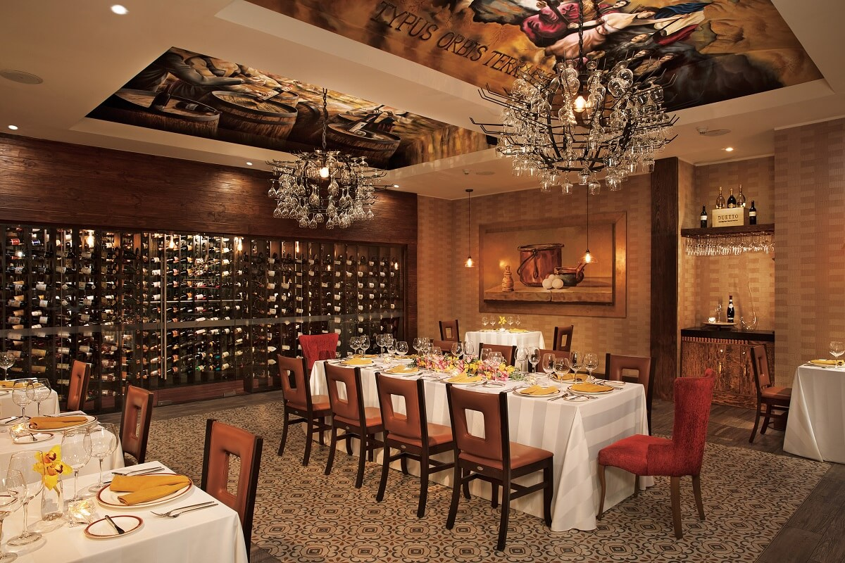 wine cellar with chandeliers and elaborate table settings