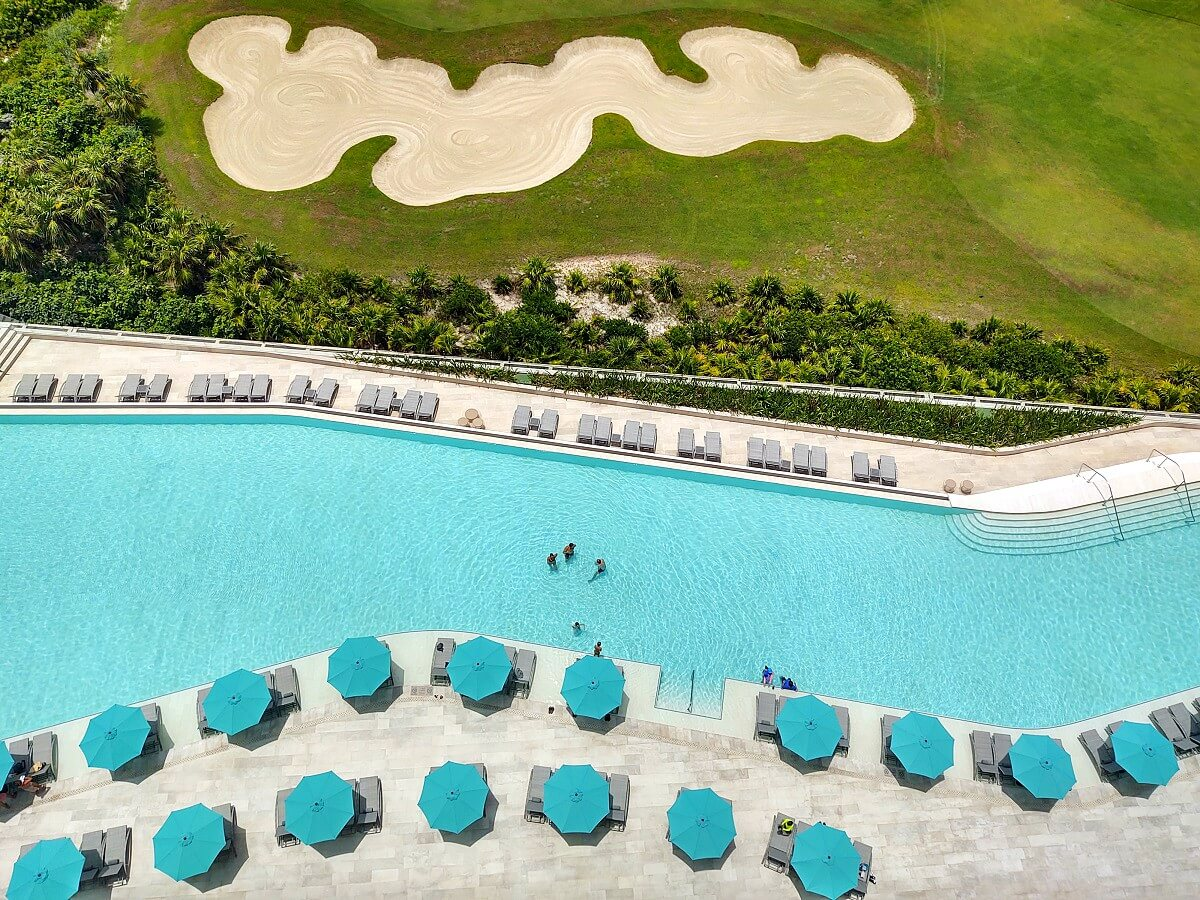 view from up top of pool and golf course dreams vista cancun