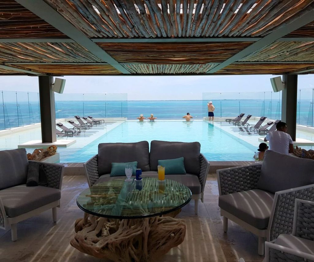 rooftop pool and lounge area with infinity pool dreams vista cancun