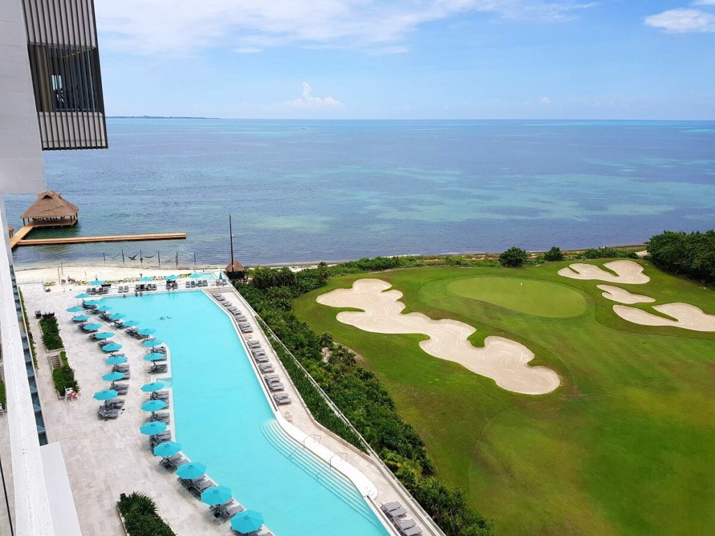dreams vista cancun view of the pool, golf course and ocean