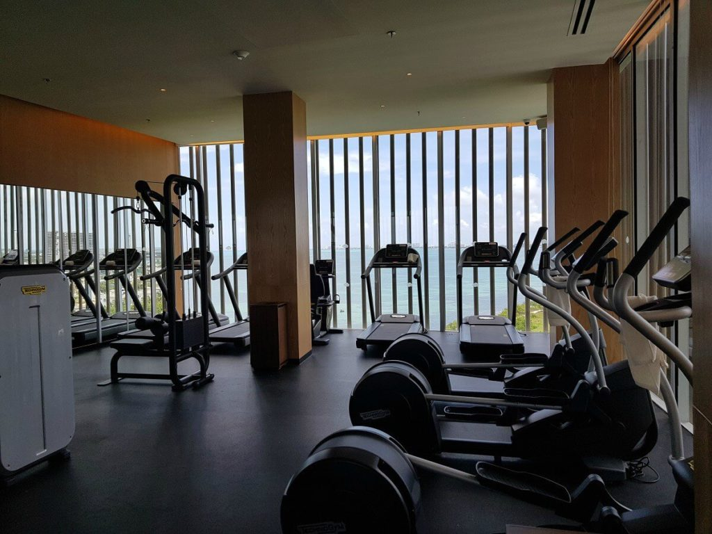 fitness center with elliptical machines, treadmills and ocean views
