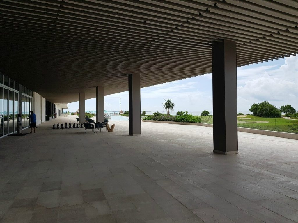 outdoor, covered large terrace with golf course views used for weddings at dreams vista cancun