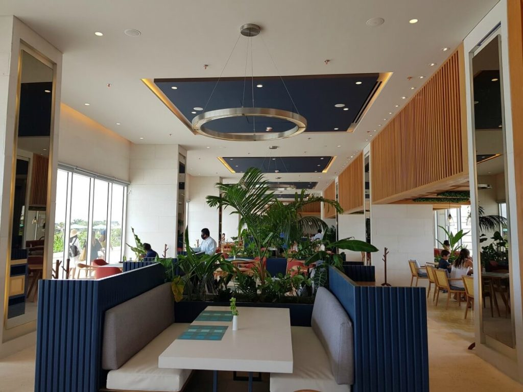 buffet restaurant interior with blue booth at dreams vista cancun