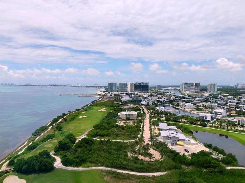 view of puerto cancun golf course and ocean from dreams vista cancun