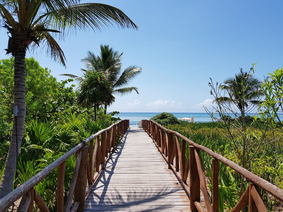 unico hotel wooden walkway to the beach