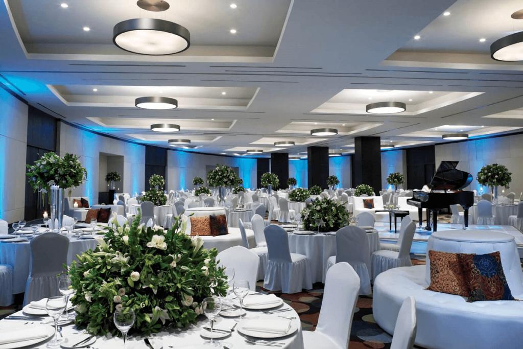 Banquet service with flower arrangements at ballroom