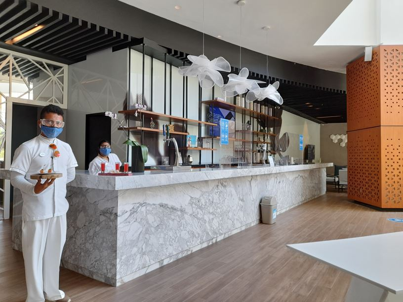 Front desk and staff with welcome drinks