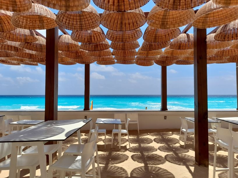 Restaurant next to the beach with wooden lamps