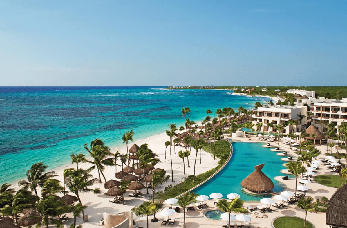 Aerial view of the resort, pools and beach at secrets akumal wedding